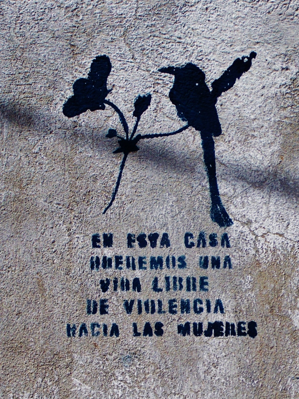 Anti Domestic violence stencils are outside most houses in Suchitoto