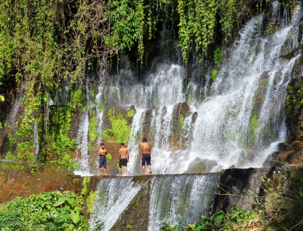 Local lads have a dip in one of the  waterfalls