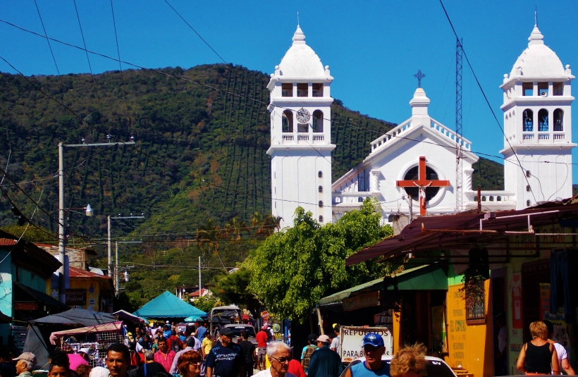 The busy streets of Juayua around the white washed church