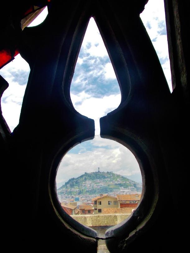 Panecillo htough a broken pane of the Basilicas stained glass