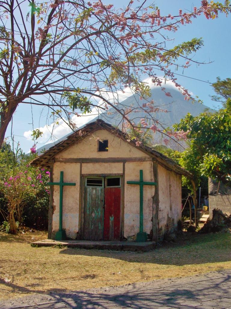 Tiny church under cherry blossom near Santo Domingo