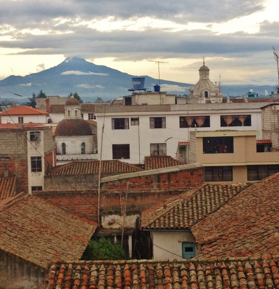 Volcano over the roof tops of Latacunga