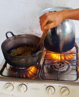 Roasting the beans on a stove