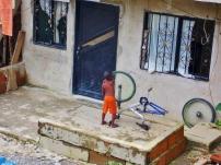 Local lad fixing his bike - San Cipriano