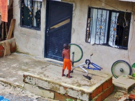 Local lad fixing his bike - San Cipriano