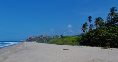 The quiet beach front and palm trees of Los Naranjos